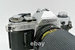 Canon AE-1 Deluxe Camera Kit + wide angle + telephoto zoom lens + 28mm + Flash