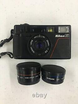 Nikon L35 AF 35mm f/2.8 Point & Shoot Film Camera with Extra Lenses. See Pictures