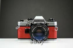 Olympus OM10 35mm Film Camera with 50mm f/1.8 Zuiko Lens Red Leather Serviced