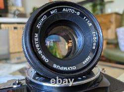 Olympus om10 35mm SLR Film Camera with 50mm 1.8 Zuiko Lens and Manual Adapter